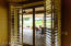 Plantation shutter doors lead to the gorgeous patio with great view.