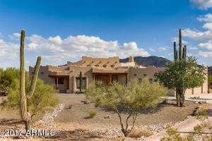 Mature landscaping with MANY saguaros throughout.