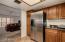 Kitchen opens to entertainment area