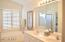 Dual Vanity with Separate Tub & Walk-In Shower in the Master Bathroom