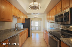 Nicely updated kitchen! New SS appliances, New Granite Counters, New fixtures, Fresh Paint