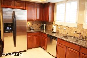 Kitchen includes stainless steel fridge.