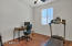 Den/Flex space w/ laminate flooring.