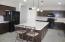Large kitchen island with pendant lighting.