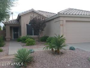 Rent includes yard maintenance which is immaculately manicured front and back landscape.The 3 Bedroom 2 Bathroom property is move in ready and comes with  The home comes with washer and dryer, stainless steel appliances, granite countertops, and  softwater system.  There is hard wood flooring throughout the house with creamic tiles in the kitchen area. Ceiling fans in all living areas keep this home cool. The relatively large patio is surrounded by an interesting stamped concrete area that merges into an immaculate green lawn surrounded by desert landscape borders.