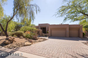 Brick Driveway and lush Desert landscaping