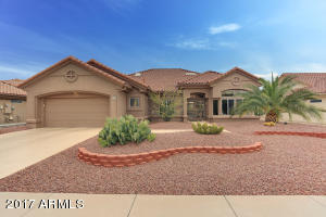 Beautiful desert landscaping front and back with upgraded, separate watering systems, Estate Home.