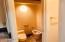 Private toilet room has pocket door