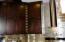 Walnut Cabinets & Custom Wine Rack