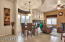 Enter to be greeted by an open floor plan, tasteful architectural details above the dining area and and airy living area .