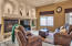 Living area boasts a natural gas gireplace, 10' ceilings, a wall of windows & sliding doors, collectors feature shelves, ceiling fan and so much more.
