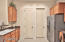 Doorway to the left is your XL pantry and laundry room with direct access to the 2 car garage to the right.