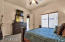 Large Master Bedroom is split floorplan and features large window to private patio.