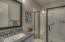 Features large walk-in shower.