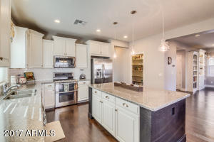 The white cabinetry and neutral granite make this kitchen feel fresh and clean! It is functional and has upgraded appliances & faucet.