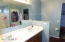 Double sinks, pony wall for toilet & tub shower combo in here