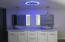 Blue night light in both bathrooms with bluetooth speakers