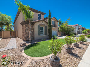 921 E. Canyon Way. Stunning curb appeal with Stone accents & architectural details.