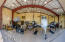 In this panoramic view, the owner's King Air 250 sits comfortably in the hangar with a variety of other vehicles. There's also a garage door on the right side, for auto entry without raising the hangar door.