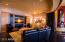 This media room portion of the Great Room, with an over $50,000 sound sysem and upgraded Hi Def flat scrreen tv, has motorized blackout curtains, and a convenient full access room behind the screen.