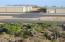 Views of the airport runway, hangars, and Pinnacle Peak and the McDowell Mountains beyond.