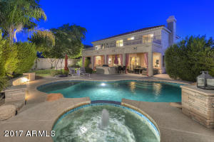 This private flood lit oasis features a heated self cleaning pool and spa, large shelf in pool plus step entry make this the perfect family pool, large grassy area, Built in BBQ, huge covered patio and misting system.