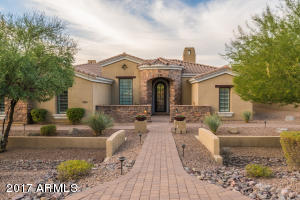 Stunning Tuscan Elegance situated on a 24K sq/ft lot in the private gated community of Rock Canyon 2 in Las Sendas.