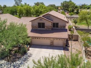 Just Reduced & Move-In Ready! This beautiful highly upgraded home has 4 bedrooms, 3 bathrooms, 3-car garage and 2,636 sf of generous living space. Features vaulted ceilings, new carpets, new fan/lighting fixtures & cozy family room with gas fireplace. Kitchen has lovely granite countertops, maple cabinets, newer appliances & microwave vented to outside, refrigerator & kitchen island. This is a popular floorplan w/one bedroom downstairs and three bedrooms, large loft & 3 walk-in closets upstairs-great for Multi-Generational family! Home has gas stubs stove & dryer. Relaxing Backyard with mature trees, large wood-burning fireplace, custom stonework, artificial grass, extended covered patio. Home is in a gated community near Marshall Ranch. This is truly a beautiful home, make it yours today!