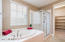 Master bathroom with separate tub and shower and walk in closet