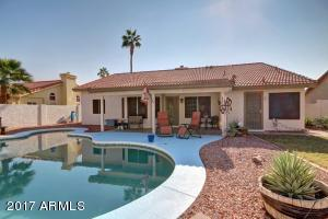 FOR SALE in Garden Lakes - Gorgeous AZ Backyard with covered patio and cool pool.