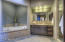 Spa tub and walk in shower.