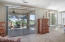 ENTERING MASTER SUITE, WITH LARGE GLASS DOORS OPENING TO YOUR OWN PRIVATE PATIO SPACE.