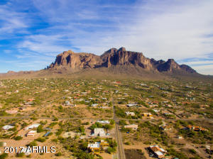 REDUCED!! Views* Circular driveway leads to the entryway of this custom home with views of the Superstition Mountains*  Privacy abounds in front and backyard as home is finished with abundance of mature landscaping* Embracing the southwest feel you will notice the hand painted front door welcoming you*The sitting room graces the entry area and offers views of the backyard and covered patio*This open floor plan offers three bedrooms with plenty of room for study, sleep and storage, two bathrooms and great room which opens to the kitchen.  Great room with fireplace and media center has views of the Superstition Mountains. Stylish kitchen with new sink, pantry and stone countertops open to dining area. Dining area has access to exterior covered patio and backyard which (see MOR