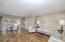 Spacious great room with wood floors and sliding door to patio