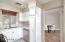 Kitchen with dishwasher, pantry with pull-out shelves, stainless sink with RO water treatment.