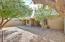 Spacious backyard with shade trees