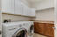 private laundry room no entry through garage a plus! washer and dryer included, cabinets and counter space to fold.