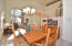 Open concept Dining & Living Rooms with 20' ceilings.