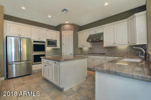 Gourmet Kitchen open to large great room for hours of fun for foodies who love to entertain.