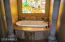 Take a nice hot bath, and enjoy the custom stained glass window while you soak a long day away.
