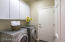 Laundry room has upper storage and washer and dryer are included.