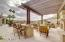 Outdoor kitchen and dining at table or bar.