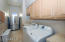Laundry room with sink and cabinets