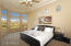 Spacious master bedroom with large windows encompassing view