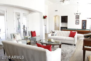 Enter the grand formal living area and notice all the natural light!