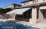 Retractable awning for shade in back pool and deck area