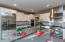 Completely re-engineered kitchen with KitchenAid stainless steel appliances and table-extended island