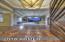 Entry welcomes you with a custom cherrywood and glass front hardwood floors, custom stained glass chandelier and an amazing view straight through the living room and telescoping glass patio doors to the outdoor living and golf course.