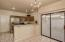 Sliding glass doors to back patio, white door in kitchen is garage entry, breakfast bar with space for four tall chairs