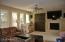 Custom Canterra around fireplace and custom large armoire